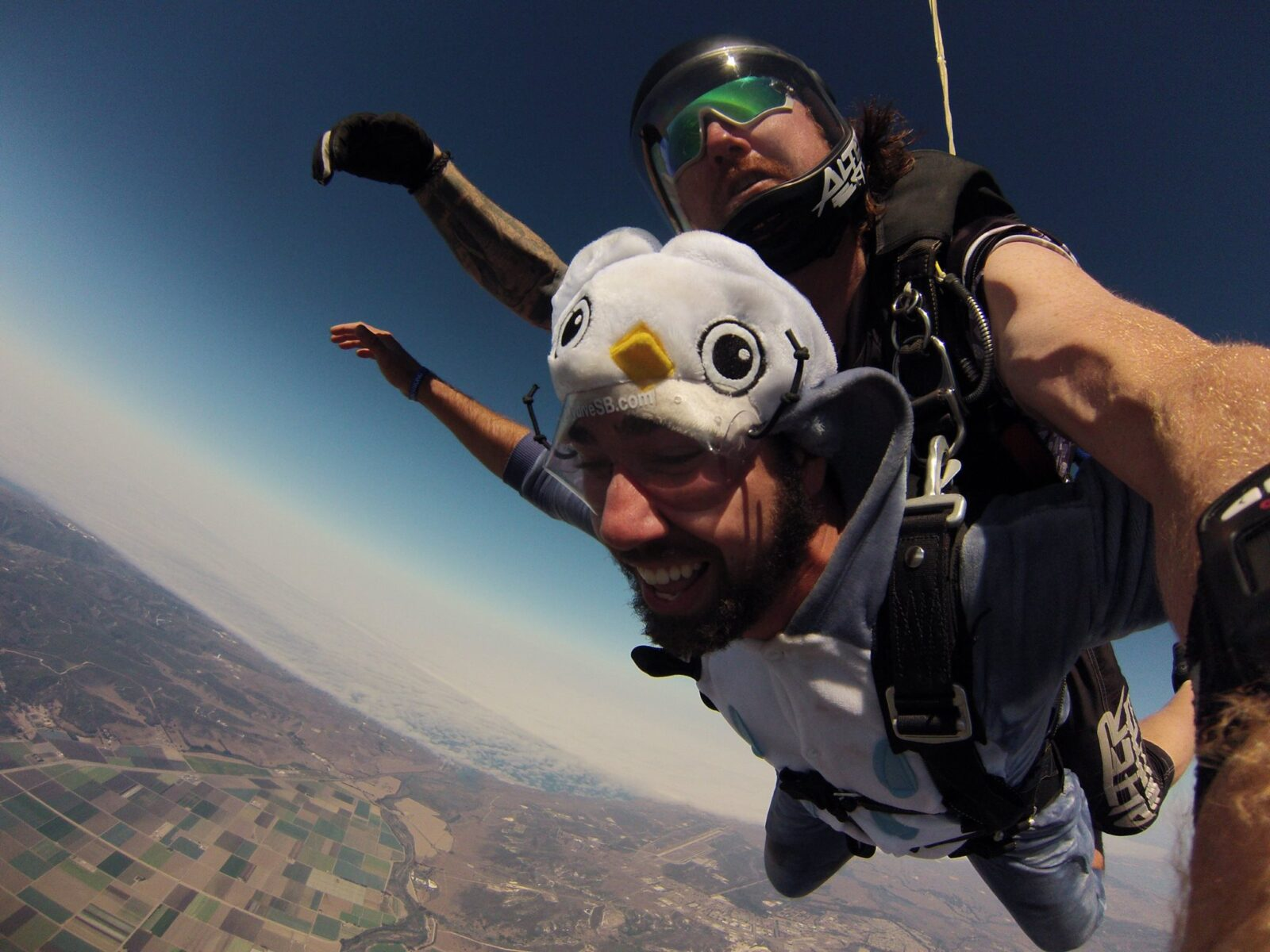 man wearing a costume while tandem skydiving