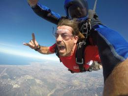 tandem skydivers, men
