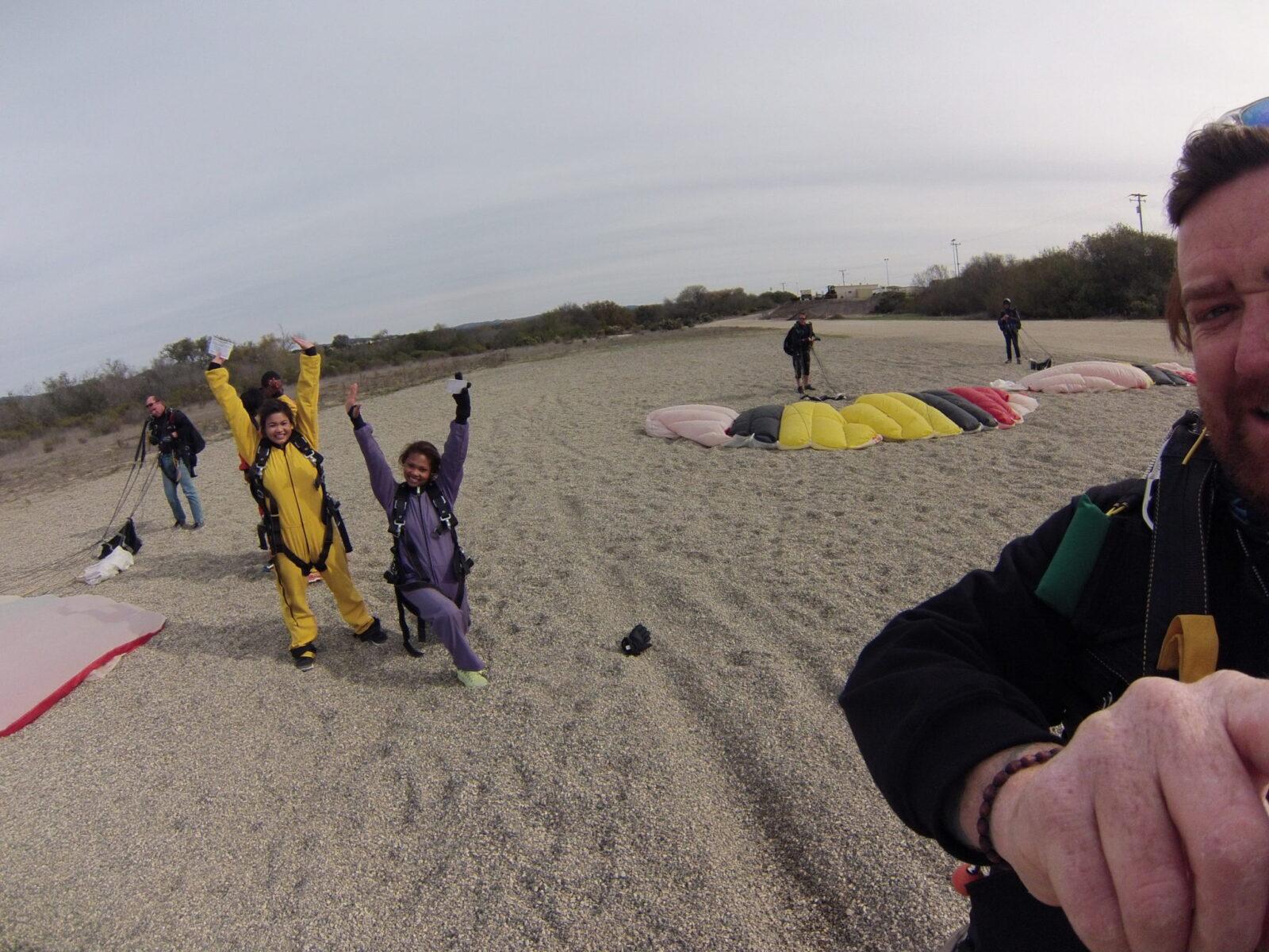 skydivers celebrating after beach landing