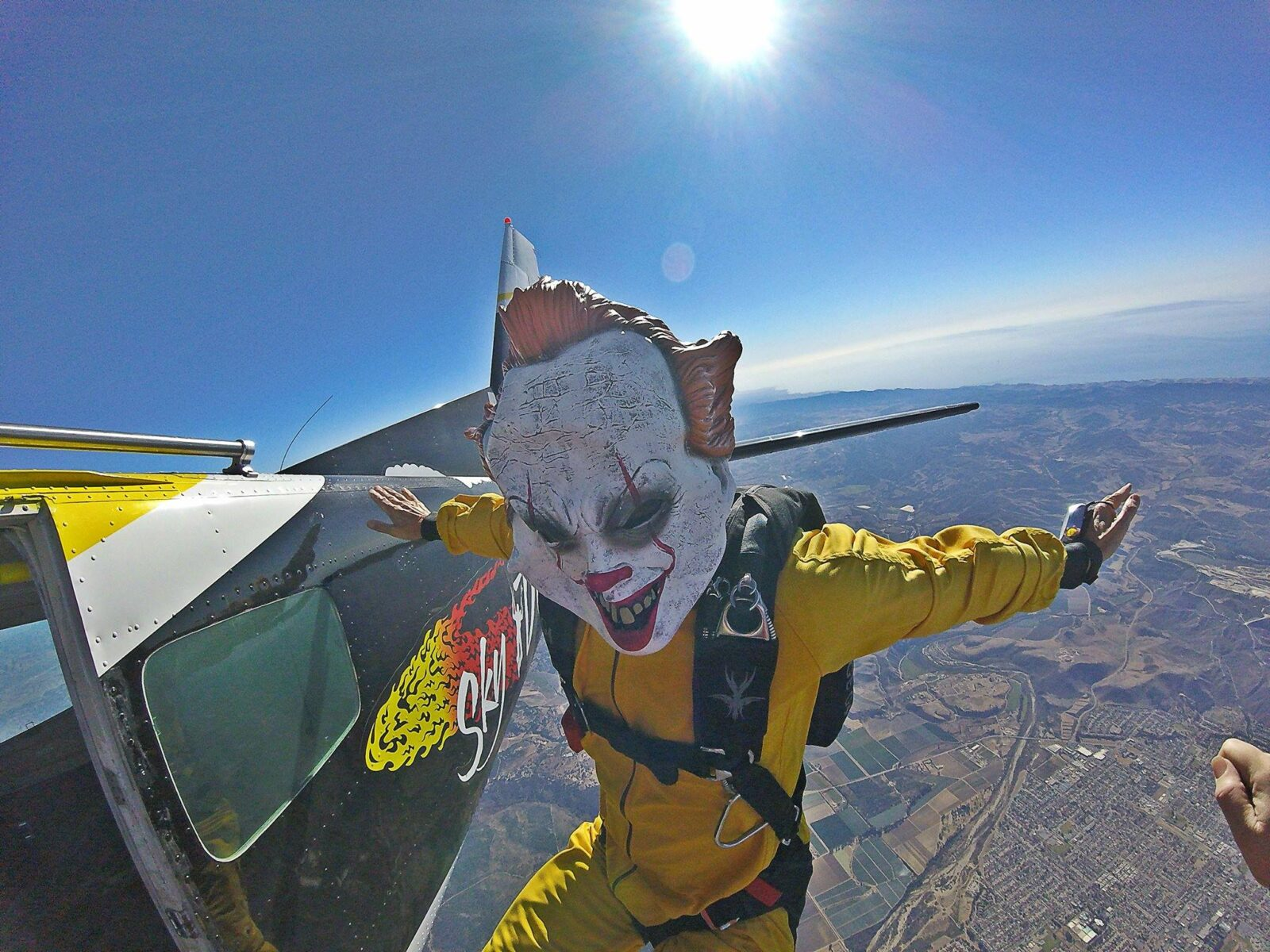 person skydiving with halloween mask on
