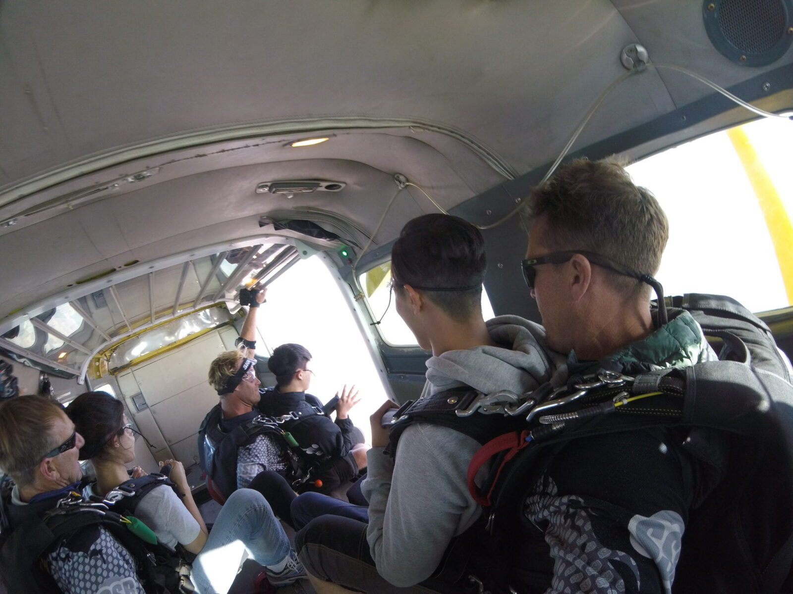 tandem skydivers getting ready to jump out of a plane at Skydive Santa Barbara