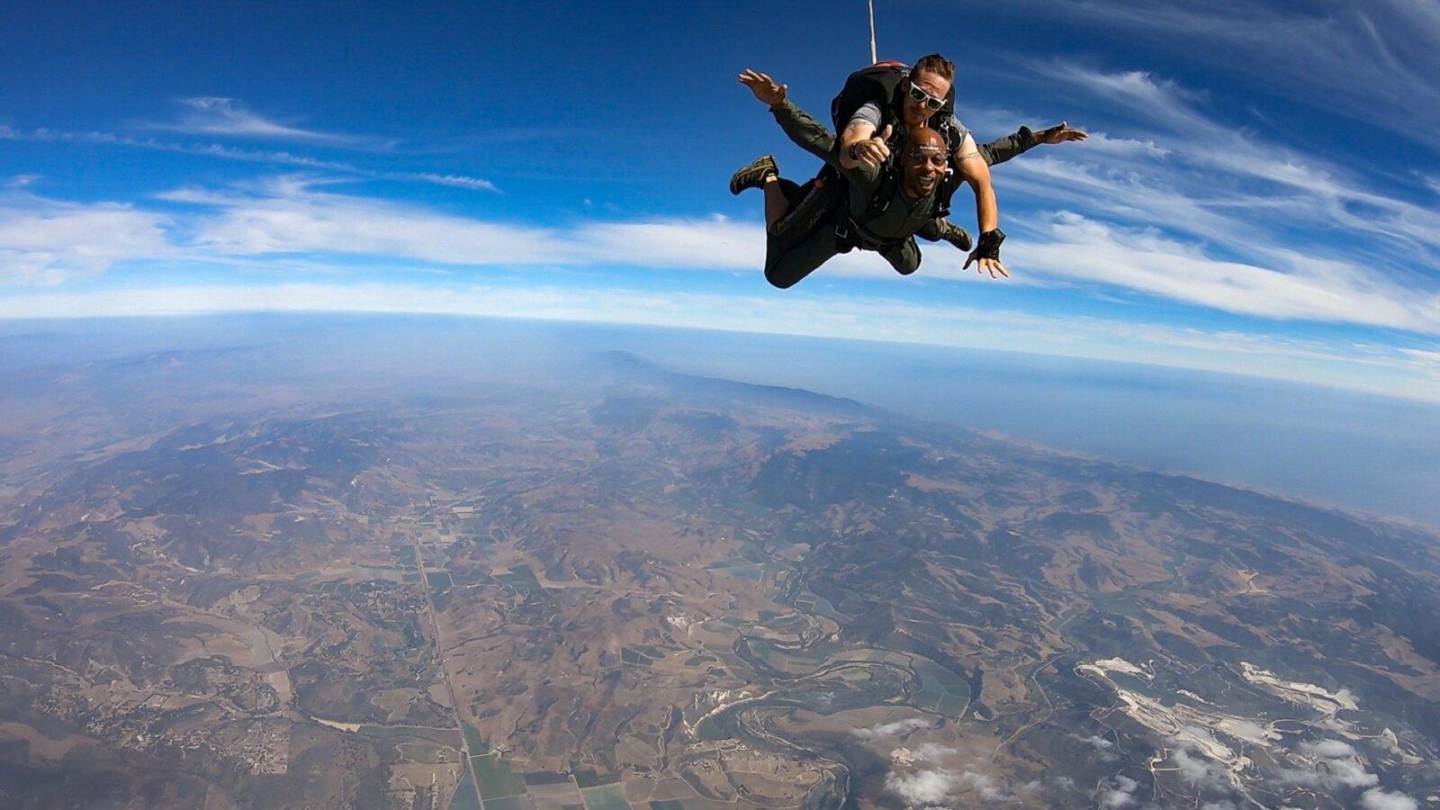 A happy jumper while tandem skydiving at Skydive Santa Barbara